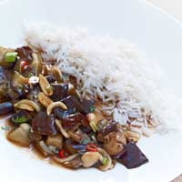 Fried eggplant and shiitake mushrooms with peanuts in a spicy sauce,