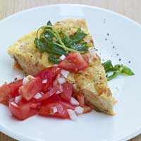 Bread omelet with sage, fresh Parmesan, and tomato salad,