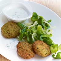 Falafel with pepper and onion salad and salted mint yogurt,