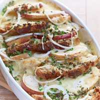Savory bread pudding with mountain cheese, onions, sliced apple, and chive sauce,