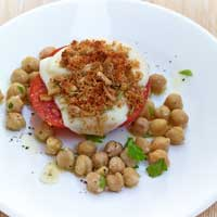 Oven tomatoes with Scamorza, pine nut crust and chickpea salad,