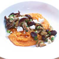 Paprika polenta with fried mushroom and feta cheese,