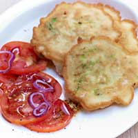 Leek and bean pancakes with tomato salad,