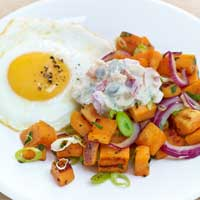 Sautéed sweet potatoes with fried egg and mixed pickle remoulade,